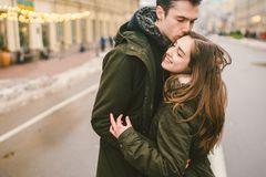 Theme love and romance. Caucasian young people heterosexual couple in love students boyfriend girl hugging and kissing on center. Of road in center of European stock photos