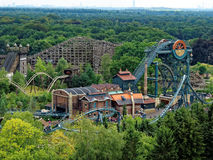 Theme park landscape with dive and wooden coaster. Aerial view to dive coaster, wooden coaster and water coaster in Efteling Theme Park, Netherlands - nestled in stock image