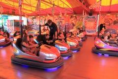 Theme park car racing Stock Images