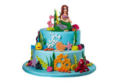 Themed cake on the sea of sugar paste, mermaid. Themed cake on the sea of sugar paste, the mermaid. On a white background Royalty Free Stock Images