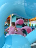 Themepark. Ride with strong blue and pink theme stock photo