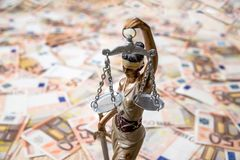 Themis against euro background. Close up Royalty Free Stock Images
