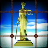 Themis behind bars Stock Photos