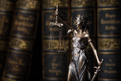 Themis figure in library. Themis figure on library background Stock Photo