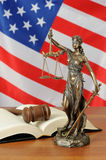 Themis and gavel with a USA flag background Royalty Free Stock Photography