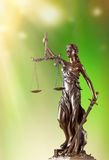 Themis in spotlight, law concept. Royalty Free Stock Images
