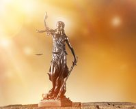 Themis in spotlight, law concept. Royalty Free Stock Image