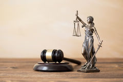 Themis statue and gavel on wooden table Stock Photography