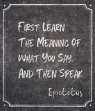 Then speak Epictetus. First learn the meaning of what you say, and then speak - ancient Greek philosopher Epictetus quote written on framed chalkboard royalty free stock photography