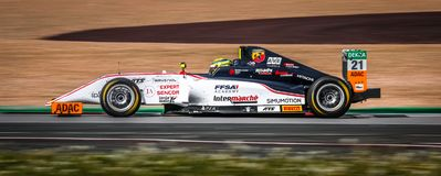 Theo Pourchaire driving a white US Racing CHRS single-seater car. Oschersleben, Germany, April 28, 2019: Theo Pourchaire driving a white US Racing CHRS single royalty free stock image