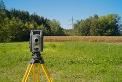 A Theodolite in a Beautiful Green Landscape stock photography