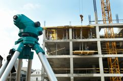 Theodolite at construction site Stock Images