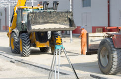 Theodolite at construction site Stock Photo