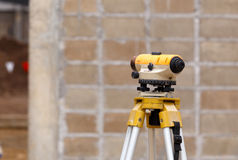 Theodolite excavator for new factory construction Royalty Free Stock Image