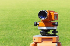 Theodolite level tool mounted on tripod Stock Photo