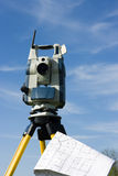 Theodolite and a map Royalty Free Stock Photography