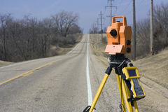 Theodolite set on the edge of road Stock Images