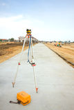 Theodolite set on the edge of road Stock Image