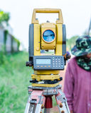 Theodolite staying on tripod, catch from below Royalty Free Stock Images