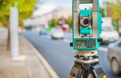 Theodolite on streen of small town Royalty Free Stock Image
