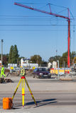 Theodolite on a tripod at the construction site Stock Images