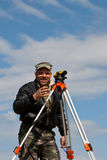 Theodolite on a tripod with construction worker Royalty Free Stock Photos
