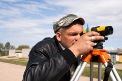 Theodolite on a tripod with construction worker Royalty Free Stock Images
