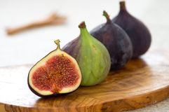 Theory of figs. Fresh figs on an olive plate Royalty Free Stock Images