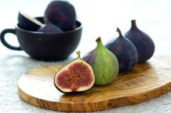 Theory of Figs. Fresh figs on an olive plate Stock Image