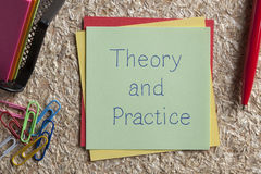 Theory and Practice written on a note. Top view of Theory and Practice written note on the wood chippings board Royalty Free Stock Images