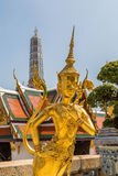 Thepnorasi. At the Wat Phra Kaew of Bangkok, statues of mythical creatures from Himmapan forest are guarding the monumental Grand Palace Stock Photo