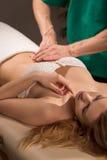Therapeutic abdomen massage Stock Image