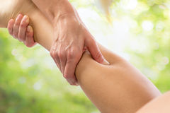 Therapeutic calf massage. Royalty Free Stock Photo