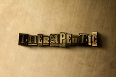 THERAPEUTIC - close-up of grungy vintage typeset word on metal backdrop  Stock Photos