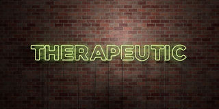 THERAPEUTIC - fluorescent Neon tube Sign on brickwork - Front view - 3D rendered royalty free stock picture Royalty Free Stock Image