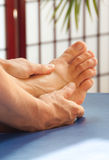 Therapeutic Foot Massage Stock Photos