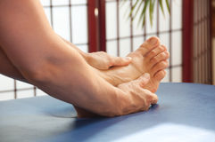 Therapeutic Foot Massage Royalty Free Stock Photo