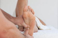 Therapeutic foot massage Stock Images