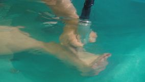 The hand massages the female foot during the hydro massage session. Therapeutic hydro massage of female foot stock video