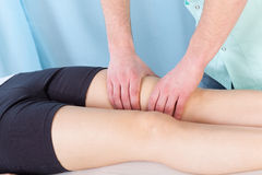 Therapeutic leg massage Royalty Free Stock Photo
