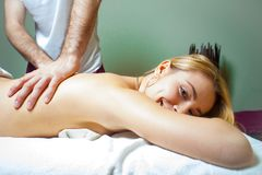 Beautiful young woman receiving massage in spa stock image