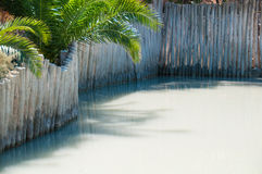 Therapeutic mud bath, surrounded by a wooden fence Stock Photos
