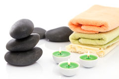 Therapeutic stones. With towels and candles in  spa Stock Photos