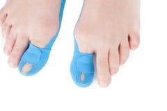 Therapeutic tape on female toe. Stock Photos
