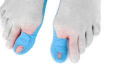 Therapeutic tape on female toe. Stock Images