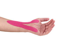 Therapeutic treatment of wrist with kinesio tex tape. Royalty Free Stock Images