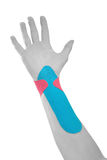Therapeutic treatment of wrist with tex tape. Stock Images