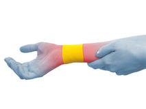 Therapeutic treatment of wrist with tex tape. Stock Photo