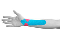 Therapeutic treatment of wrist with tex tape. Royalty Free Stock Photos
