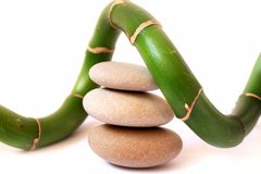 Theraphy spa stones with bamboo. Massage spa stones and bamboo, spa concept royalty free stock photography